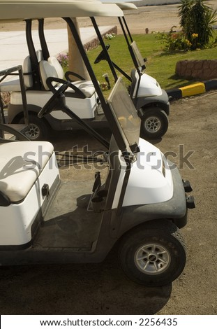 Electroautomobiles for movement on fields for a golf - stock photo