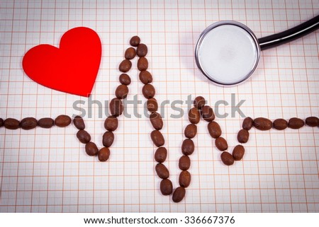 Electrocardiogram line of roasted coffee grains, medical stethoscope and red heart on graph paper, ecg heart rhythm, medicine and healthcare concept - stock photo