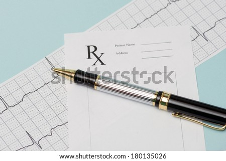 Electrocardiograph with prescription and pen. - stock photo