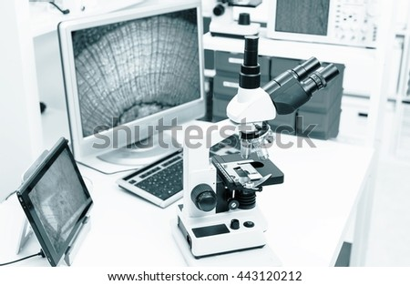 electron microscope in the histology laboratory. Blue colored image - stock photo