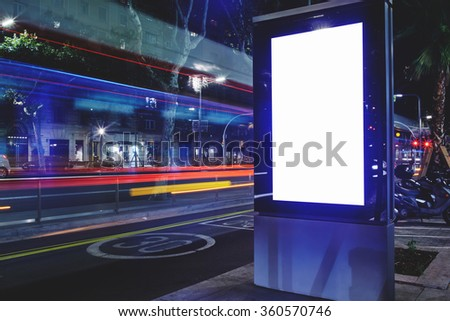 Electronic advertising board with copy space screen for your text message or content, banner with blurred movement of cars on background, empty poster outside, public information billboard on roadway - stock photo