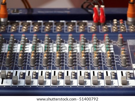 Electronic audio mixer with various inputs and controls