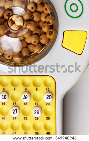 electronic bingo game with balls to play. Vertical image viewed from above. - stock photo