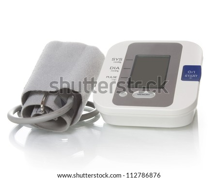 Electronic blood pressure meter and cuff - stock photo