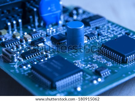 electronic board toned blue, close up photo