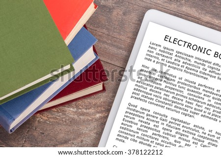 Electronic book and books, top view (lorem ipsum text used) - stock photo