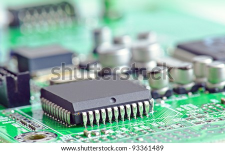 electronic chip on circuit board - stock photo