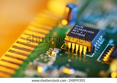 Electronic chip on circuit board. Macro close-up, shallow DOF. - stock photo