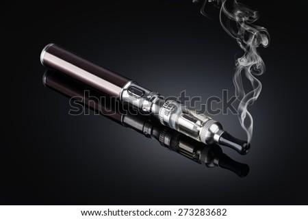 electronic cigarettes isolated on black - stock photo