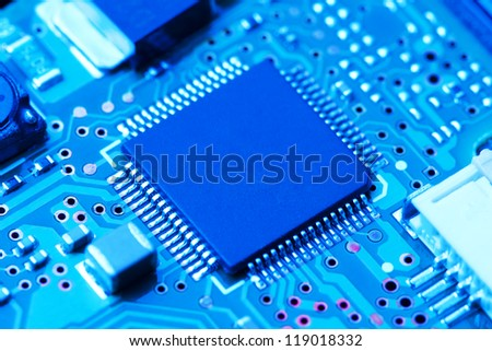 electronic circuit board with processor - stock photo