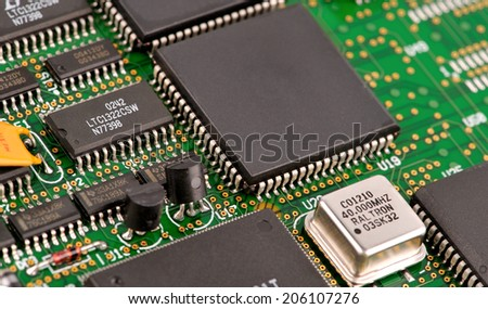 electronic circuit board with processor  as an abstract background pattern - stock photo