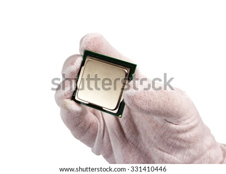 Electronic collection - Computer processor from the top side in hand isolated on white background - stock photo