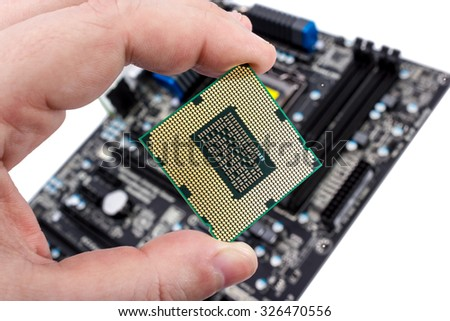 Electronic collection - Computer processor in hand before installation into the motherboard - stock photo