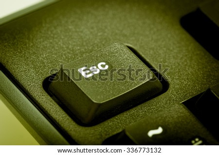 Electronic collection - detail black computer keyboard. The focus on Esc key. Toning is green. - stock photo