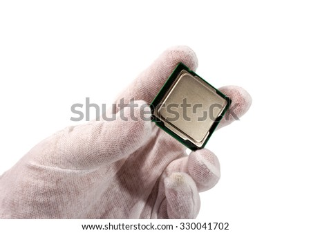 Electronic collection - Hand and computer processor from the top side isolated on white background - stock photo