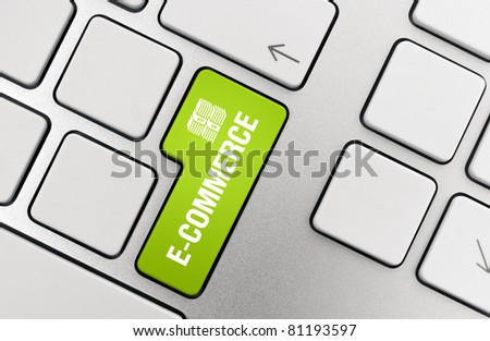 Electronic commerce key on modern aluminum keyboard. - stock photo
