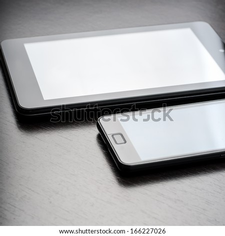 electronic devices on wooden table, close up - stock photo