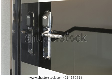 Electronic door knob on black door