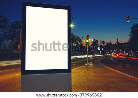 Electronic empty billboard with copy space for your advertising text message or content, public information board in urban scene, clear Light-box with night city on background, promotional mock up - stock photo
