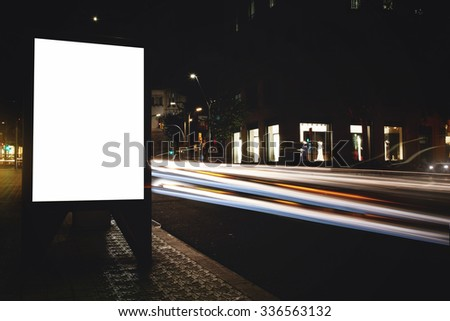 Electronic empty billboard with copy space for your text message or content, public information board with light streaks on background, advertising mock up in urban setting, clear poster on roadway  - stock photo