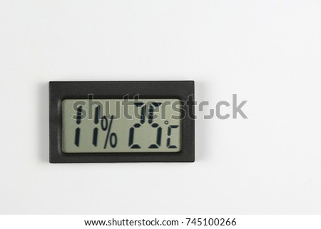 electronic humidity meter and temperature on white background