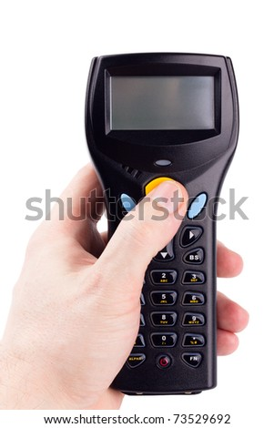 Electronic manual scanner of bar codes in man hand - stock photo