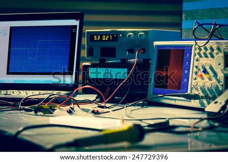 electronic measuring instruments in hitech computer laboratory - stock photo