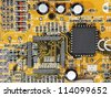 Electronic microcircuit and microchip taken closeup. - stock photo
