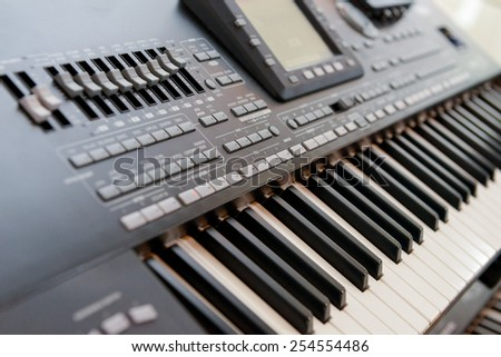 Electronic organ with many buttons and digital display - stock photo