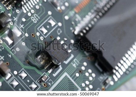 Electronic part malfunction, white smoke over the plate with chip.