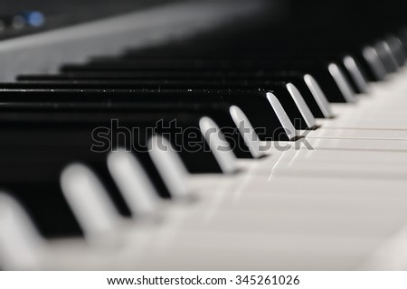 Electronic piano prepared for the concert. White and black keys ready to play sound. - stock photo