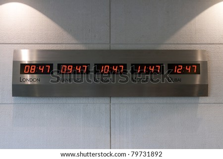 Electronic scoreboard showing the time in the five capitals of the world - stock photo