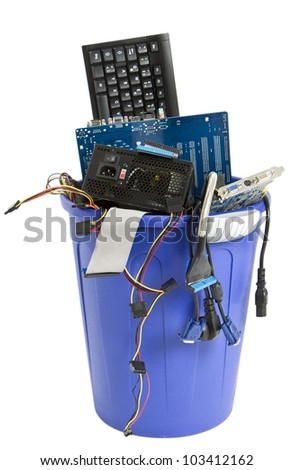 electronic scrap in trash can. keyboard, cables, logicbaord, power supply - stock photo