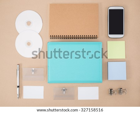 electronic tools in every day life,  notebook smart phone cd Office Supply - stock photo