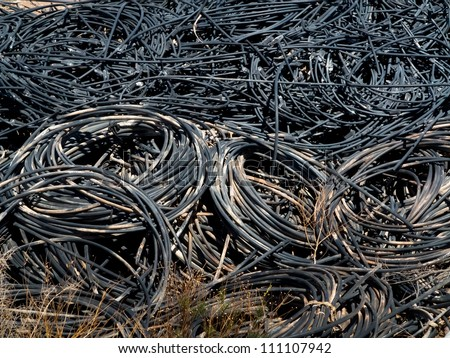 Electronic waste - Piles of waste cables at junkyard  - stock photo