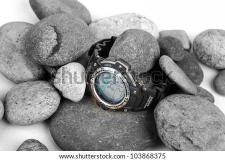 Electronic waterproof watch on stone