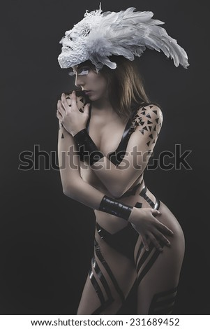 elegance,  beautiful woman with white mask, naked and black strips - stock photo