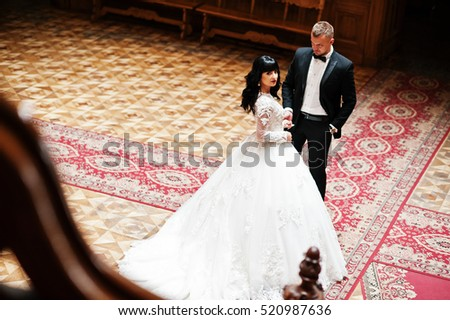 Elegance wedding couple in love at royal palace.