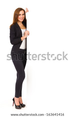 Elegance woman stands with blank banner. Full length studio shot isolated on white. - stock photo