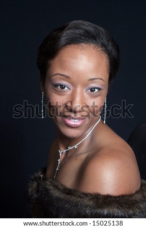 Elegant African American woman smiling - stock photo