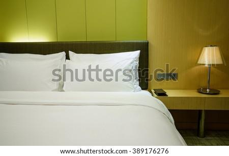 Elegant and comfortable home & hotel bedroom interior. - stock photo