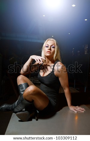 elegant and sexy blonde woman on a dark background