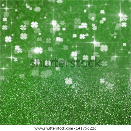 Elegant and shiny St. Patrick�´s Day illustration: Green glitter and clover bokeh background with sparkling bright stars. - stock photo