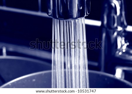 Elegant and simple kitchen faucet - stock photo