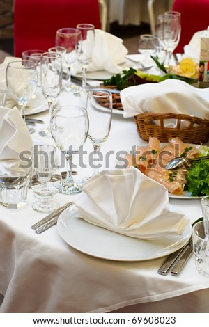 Elegant banquet and dinner tables prepared for a holiday or a party. - stock photo