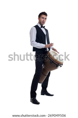 Elegant bearded man plays on percussion - stock photo