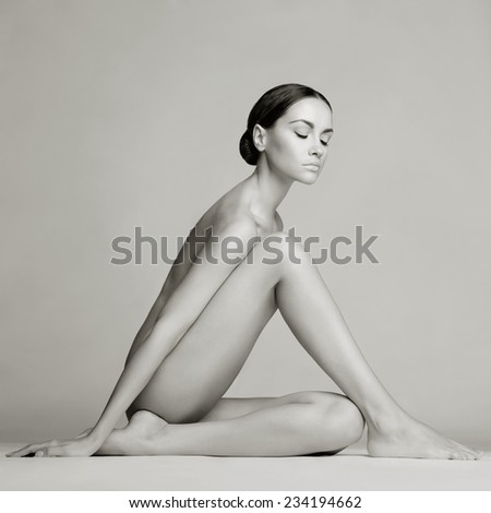 Elegant beautiful sitting lady on white background - stock photo