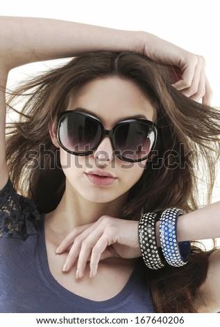 Elegant beautiful woman with fanning hairs and stylish fashion sunglasses - stock photo