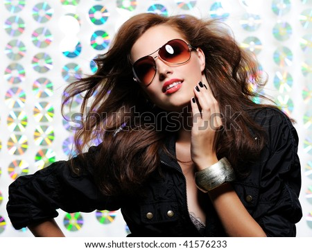 Elegant beautiful  woman  with fanning hairs and  stylish fashion sunglasses - stock photo