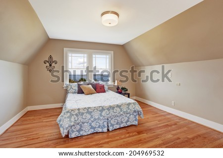 Elegant bedroom interior  in light ivory tone Furnished with bed in light blue  with colorful pillows